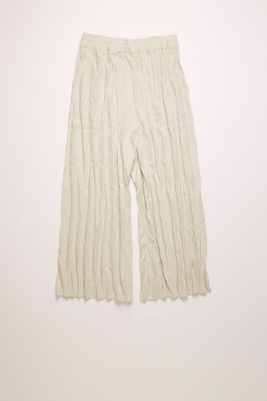 Acne Studios white melange culottes are crafted from linen with crinkled pleats and feature a mid-rise elasticated waistband and patch pockets at the back.