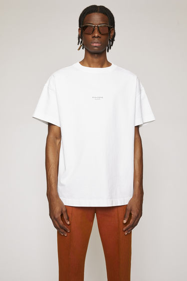 Acne Studios optic white t-shirt is shaped for an oversized fit and completed with an upside-down Acne Studios logo on the chest.