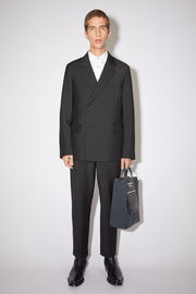 Acne Studios black suit jacket is made from lightweight wool and mohair-blend to a double-breasted silhouette and is fully lined in satin. It's defined with notch lapels and padded shoulders and wrapped over the front with concealed buttons.