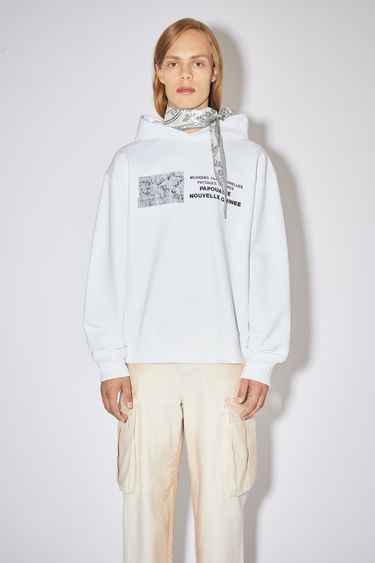 Acne Studios optic white hooded sweatshirt is made of cotton with a print at the front, in collaboration with Dizonord, a record store in Paris, France.