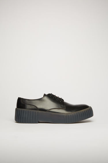 Acne Studios black/grey shoes are shaped to a classic derby silhouette. They're crafted from polished leather to an almond-toe shape and set on a chunky ribbed-rubber sole.