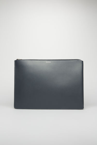 Acne Studios dark blue document holder is crafted from soft cow leather and accented with a silver-tone zip closure and foil branding on the front.