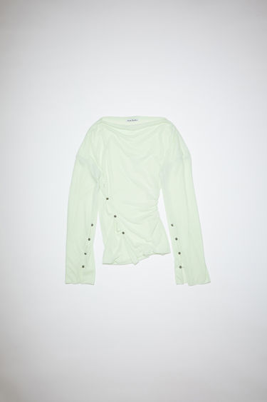 Acne Studios light green long sleeve crepe t-shirt features dropped shoulders and ornate metal button closures.