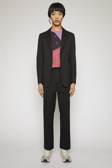Acne Studios dark blue/black pinstriped suit jacket is crafted from a lightweight cotton-blend suiting and features lightly padded shoulders and patch pockets.