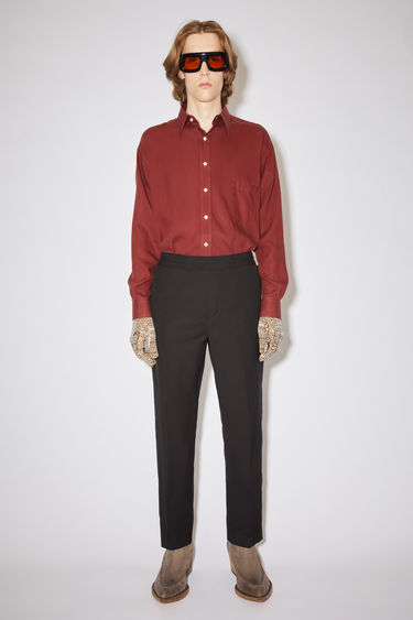 Acne Studios black casual trousers are made of cotton with an elasticised drawstring waist.