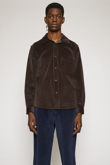 Acne Studios coffee brown shirt is crafted from soft corduroy to a boxy silhouette, with a chest pocket and snap button closures.