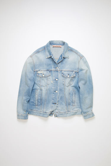 Acne Studios light blue rigid denim jacket is made of cotton with a heavily distressed, stitched up design.