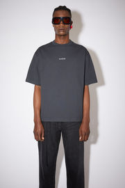 Acne Studios black t-shirt is crafted from organically grown cotton that's garment dyed to create a soft, washed out finish. It's cut for a relaxed fit and features a raised logo lettering on front.