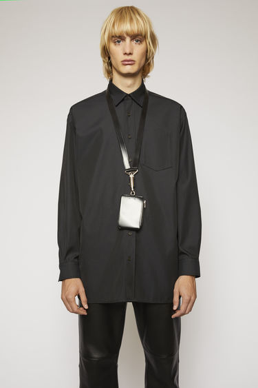 Acne Studios black oversized shirt is crafted from a cotton-blend twill with a subtle lustre finish and finished with a patch pocket on the chest.