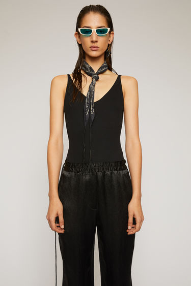 Acne Studios black sleeveless bodysuit is crafted from stretchy cotton-blend jersey with a deep v-neck, and a scooped back and secured with a press-stud fastening base.