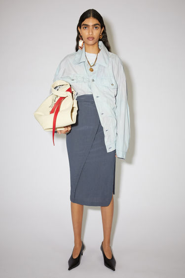 Acne Studios mid blue draped skirt is made of a viscose/silk blend with a fitted silhouette.