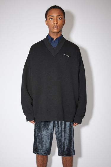 Acne Studios black v-neck sweater is a double face knitwear in wool and cotton with an embroidered logo at the chest.