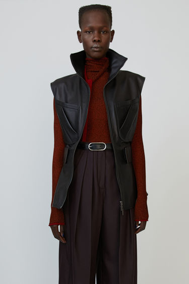Acne Studios black zip-up gilet is crafted from lamb leather to a flared silhouette and shaped with an elasticated waist.