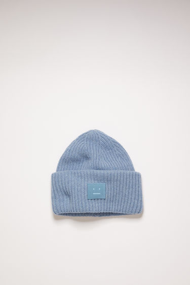 Acne Studios mineral blue beanie is knitted in a thick rib-stitch from soft wool and features a tonal face-embroidered patch on the turn-up.