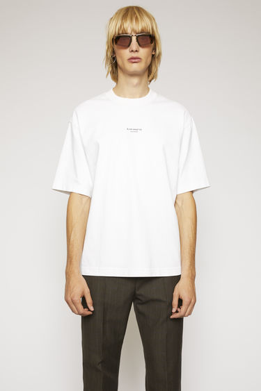 Acne Studios optic white t-shirt is cut from midweight cotton jersey to a boxy silhouette and then accented with a reversed logo across the chest.