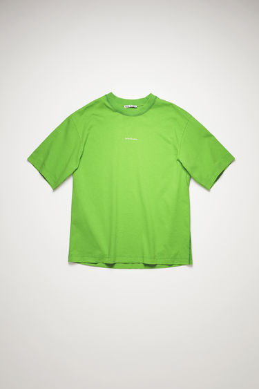 Acne Studios bright green t-shirt is crafted from organically grown cotton that's garment dyed to create a soft, washed out finish. It's cut for a relaxed fit and features a raised logo lettering on front.