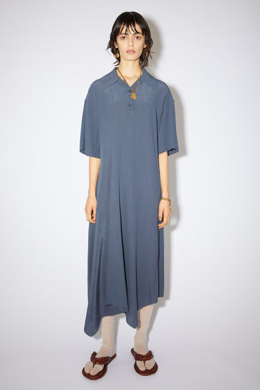 Acne Studios mid blue asymmetric hem dress is made of a crinkled viscose/silk blend crepe with a relaxed fit.