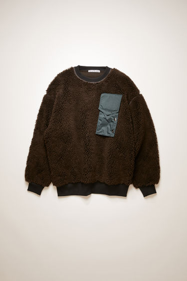 Acne Studios dark brown sweatshirt is crafted from heavy fleece to an oversized silhouette with contrasting trims and features ripstop buttoned pocket and back panel.