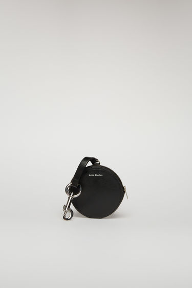 Acne Studios black coin purse is crafted from smooth leather and comes equipped with a branded lobster clasp that can be attached to bags and belt loops.