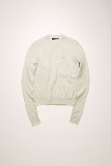 Acne Studios light grey melange crew neck sweater is made from wool with a face logo patch and ribbed details.