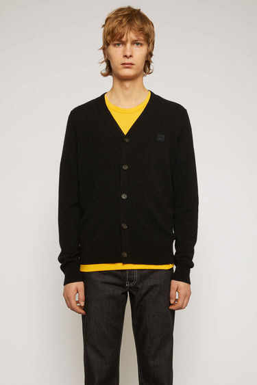 Acne Studios black cardigan is finely knitted from pure wool with a V-neckline and accented with a tonal face-embroidered patch.