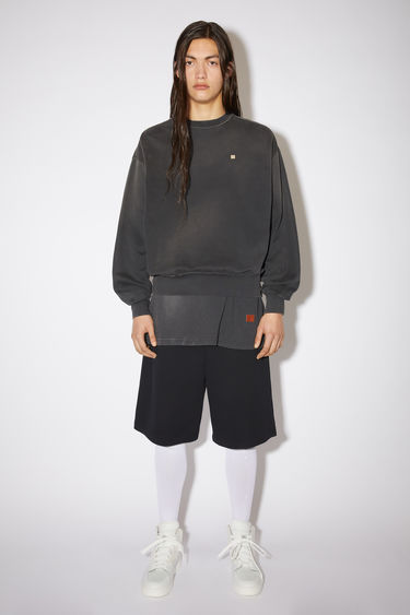 Acne Studios black relaxed bubble fit sweatshirt is made of organic cotton with a contrasting face patch and embroidery.