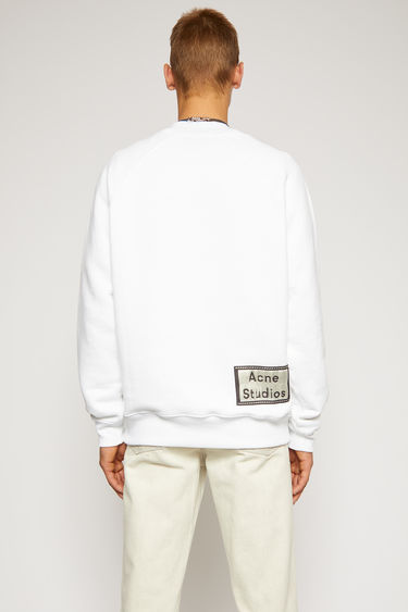Acne Studios optic white sweatshirt is crafted from melange loopback jersey and has a reversed label patch at the lower back.