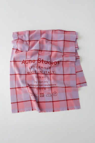 Acne Studios pink/lilac scarf is patterned with a check design and features a screen printed Acne Studios logo and care label.