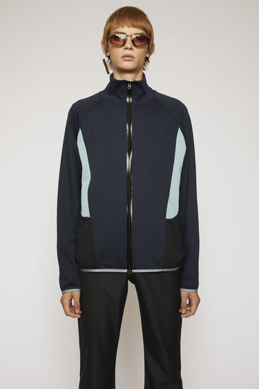 Acne Studios navy blue jacket is made from technical loopback jersey with a subtle lustre finish and it has contrasting side panels and branded zip plackets for a sporty finish.
