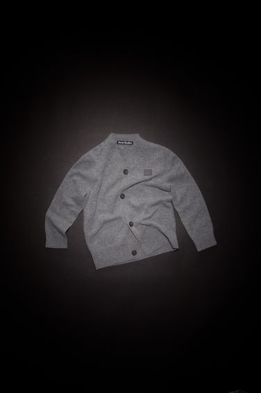 Acne Studios grey melange cardigan is knitted from soft wool in a fine gauge and accented with a tonal face-embroidered patch on the chest.