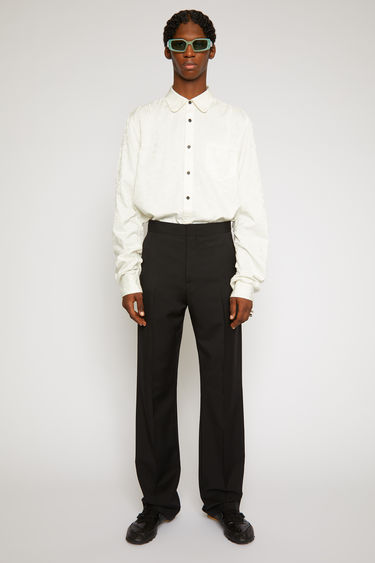 Acne Studios black trousers are cut from a wool and mohair-blend in a straight-leg shape and accented with a creased satin waistband.