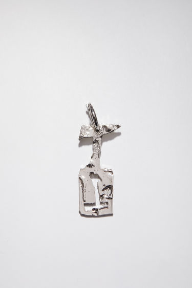 Acne Studios silver earring is crafted with a hammered pendant and features a stencil of the letter 'T', then secured via a hinge fastening.