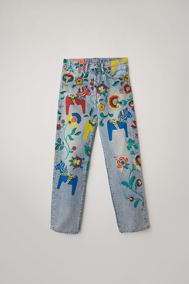 Acne Studios 1996 Dala light blue jeans are covered with traditional Dala horse print along the legs. Crafted from rigid denim, they're cut to sit high on the waist with a straight fit from the hips.