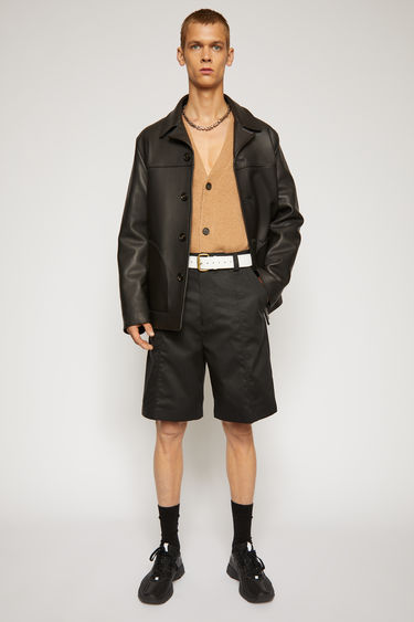 Acne Studios black shorts are cut from a technical cotton twill with a high-rise waist and wide legs and finished with wide belt loops and patch pockets.