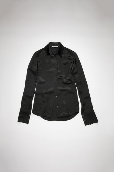 Acne Studios black long sleeve shirt is made of fluid satin with a fitted silhouette.