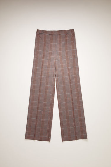 Acne Studios pink/purple checked trousers are tailored in a straight-leg shape with an elasticated waistband and has a faux front placket and neatly pressed creases.
