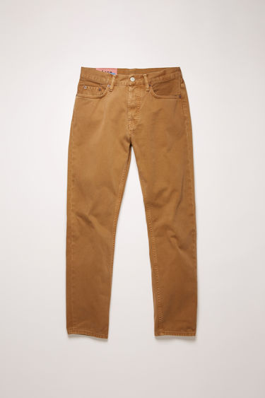 Acne Studios River Caramel Twill jeans are crafted from cotton twill that's garment dyed to add softness and give a lived-in appeal. They're shaped to sit high on a waistband before falling to a slim, tapered leg.