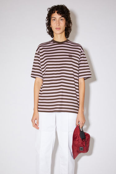 Acne Studios lilac purple striped t-shirt is made from organic cotton with a crew neck, relaxed fit, and a face logo patch.