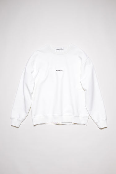 Acne Studios optic white sweatshirt is made from pigment-dyed jersey that's lightly faded along the seams. It's cut to a relaxed silhouette with dropped shoulders and features a raised logo print on front.