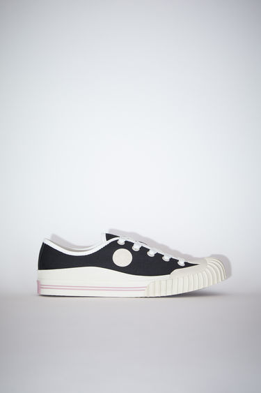Acne Studios black sneakers take cues from traditional baseball gears. They're crafted from cotton-canvas to a low-top style which laces through the front and has a rubberised logo patch on top of textured rubber soles.