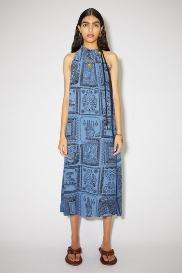 Acne Studios indigo blue printed dress is made of a viscose/silk blend, featuring an asymmetric drawstring neckline.