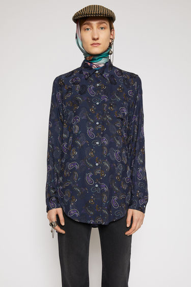 Acne Studios black/purple shirt is crafted from lightweight viscose that's printed with paisley motifs. It's cut to a relaxed silhouette and finished with elongated shirttail hem and a chest patch pocket.