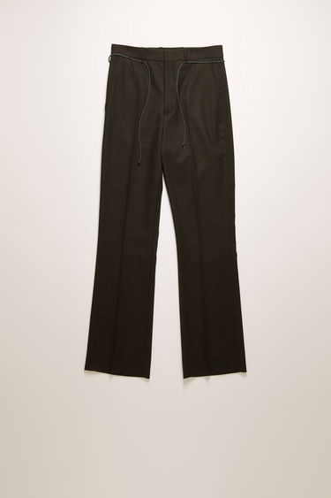 Acne Studios grey melange trousers are cut from virgin wool twill with bootcut legs and accented with a technical drawcord on the waist.