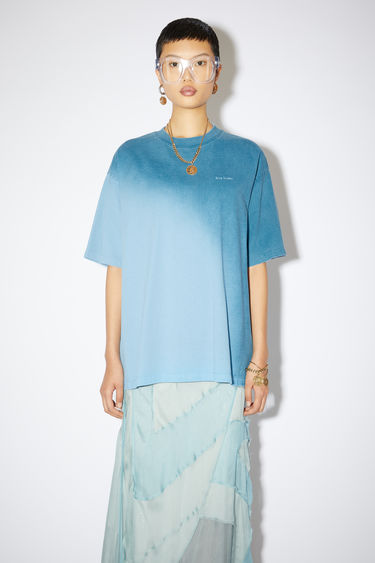 Acne Studios aqua blue/dusty blue crew neck t-shirt is made of cotton with a hand-applied spray treatment.