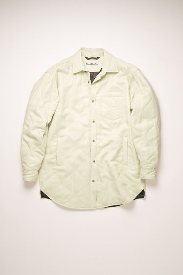 Acne Studios meadow green padded overshirt is crafted from satin viscose quilted in a ripple pattern and has a point collar, chest patch pocket and two side welt pockets.