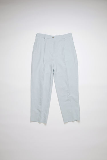 Acne Studios ice blue pleated trousers are made of a linen/cotton blend with a classic fit.