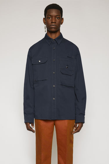 Acne Studios navy overshirt is crafted to a boxy silhouette from durable cotton twill and features a multi-layered patch pockets on the chest.