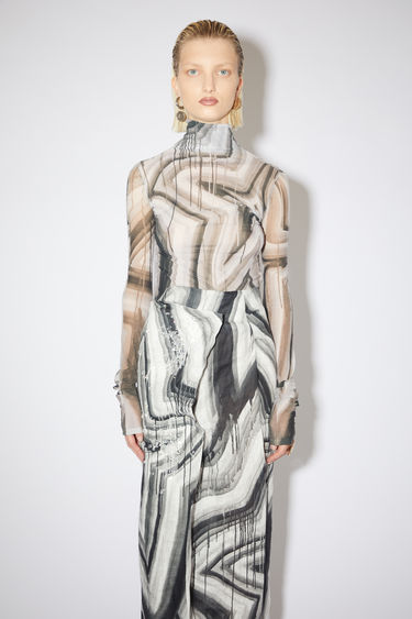 Acne Studios black/white long sleeve t-shirt is made of star-printed nylon with a second skin fit.