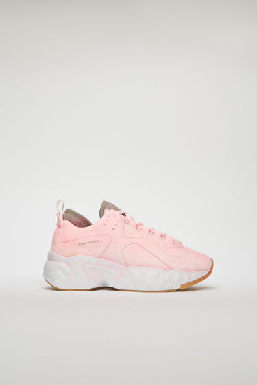 Acne Studios Manhattan Overdyed white sneakers takes cues from '90s American urban sportswear. They are crafted to a bulky silhouette with a sculpted platform sole and individually finished with a spray treatment. The size runs larger, please take a size smaller than usual.