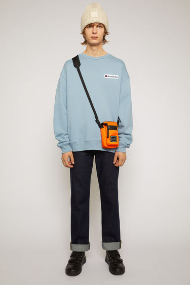 Acne Studios mineral blue sweatshirt is crafted from midweight loopback jersey to an oversized silhouette and accented with a logo-embroideed patch on the chest.